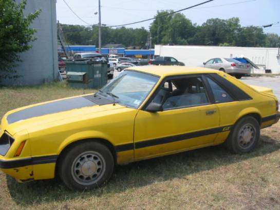 1986 Ford Mustang 5.0 HO - Yellow - Image 1