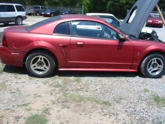1999 Ford Mustang 5.4 8 cyl. T-45 Five Speed- Burgundy - Image 1
