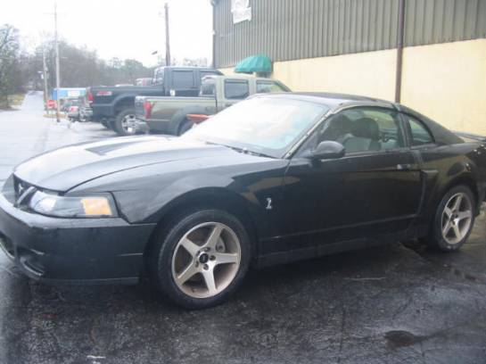 2003 Ford Mustang 4.6 Super-Charged 4 valve 5spd- Black - Image 1