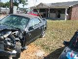 2003 Ford Mustang 4.6 2V 5 spd- black w/ black top - Image 2