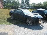 2003 Ford Mustang 4.6 2V 5 spd- black w/ black top - Image 3